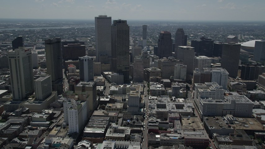 5K aerial video follow Bourbon Street into Downtown New Orleans, Louisiana Aerial Stock Footage | AX59_007