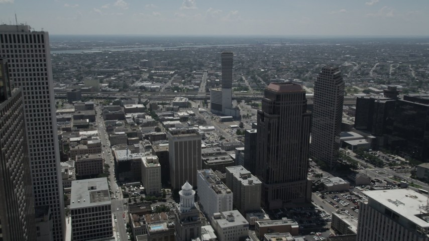 5K stock footage aerial video fly over Downtown New Orleans skyscrapers and approach Plaza Tower, Louisiana Aerial Stock Footage | AX59_008