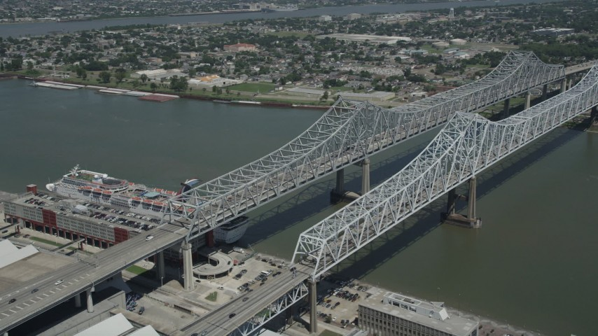 5K stock footage aerial video of Crescent City Connection Bridge spanning the Mississippi River, New Orleans, Louisiana Aerial Stock Footage | AX59_009