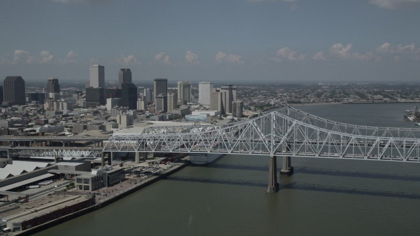 5K stock footage aerial video of Crescent City Connection Bridge and Downtown New Orleans skyscrapers, Louisiana Aerial Stock Footage | AX59_011