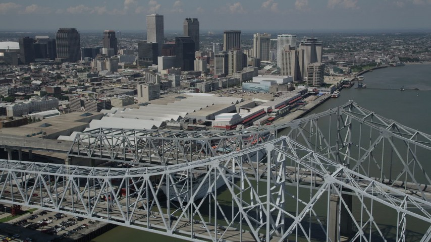 5K stock footage aerial video flying over the Crescent City Connection, with view of convention center and Downtown New Orleans, Louisiana Aerial Stock Footage | AX59_012