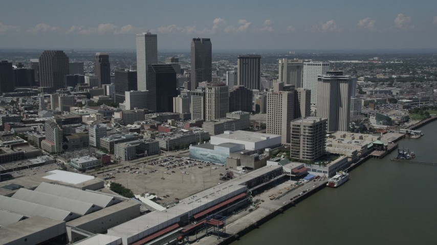 5K stock footage aerial video of Downtown New Orleans skyscrapers seen from the Mississippi River, Louisiana Aerial Stock Footage | AX59_013