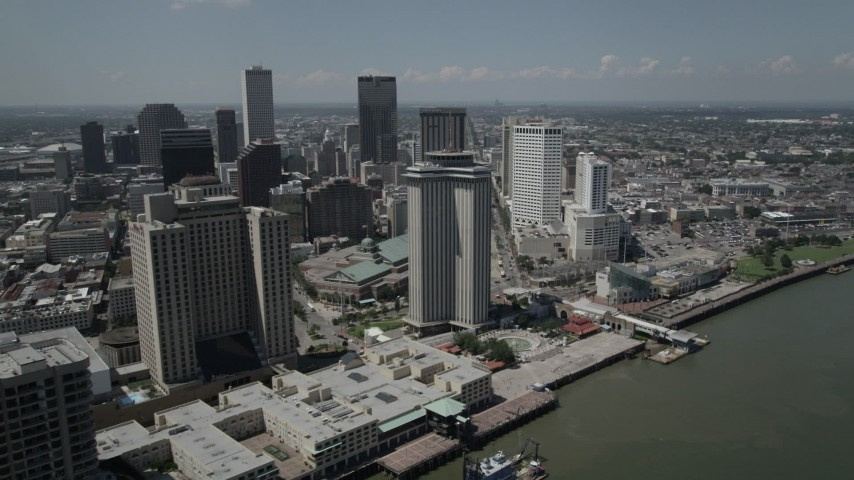 5K aerial video of Hilton New Orleans and World Trade Center building in Downtown New Orleans, Louisiana Aerial Stock Footage | AX59_014