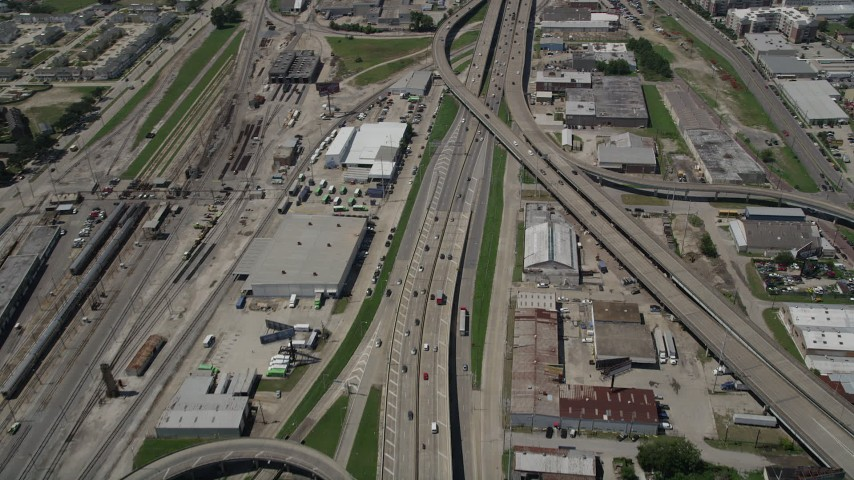 5K stock footage aerial video of light traffic on the I-10 / Highway 90 interchange in Mid-City New Orleans, Louisiana Aerial Stock Footage | AX59_020