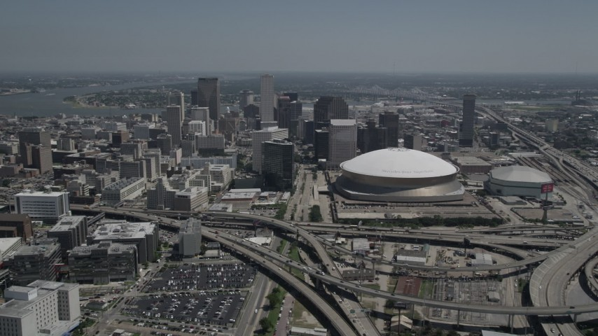 5K aerial video of Downtown New Orleans skyscrapers and the Mercedes-Benz Superdome, Louisiana Aerial Stock Footage | AX59_021