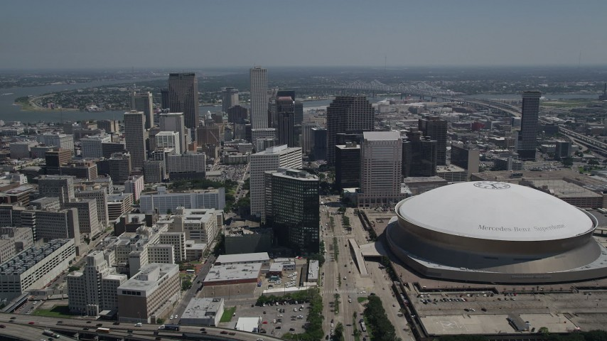 5K aerial video approach Downtown New Orleans skyscrapers and Mercedes-Benz Superdome, Louisiana Aerial Stock Footage | AX59_022