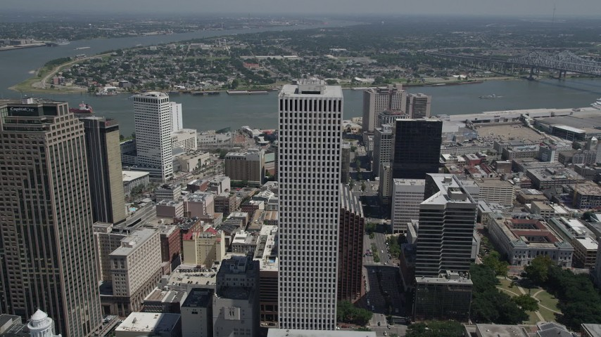 5K stock footage aerial video fly over One Shell Square to reveal Harrah's casino, Downtown New Orleans, Louisiana Aerial Stock Footage | AX59_024