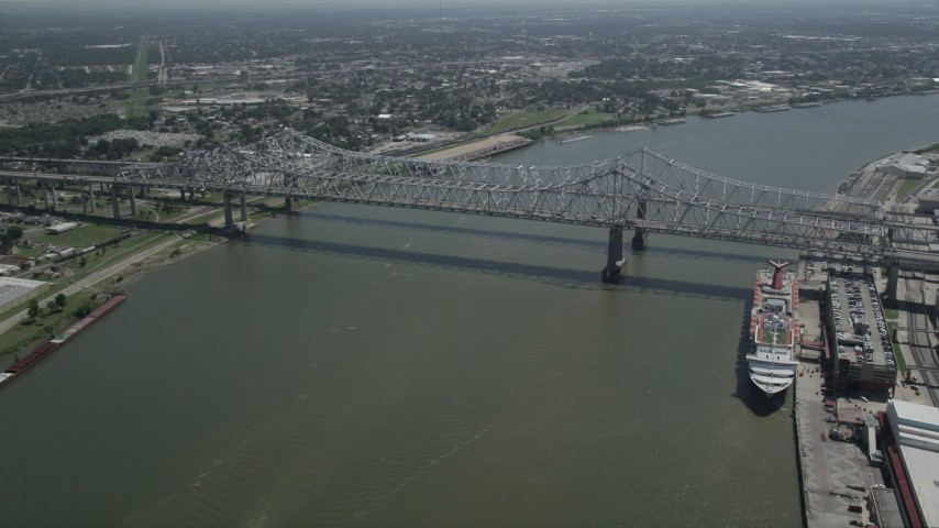 5K stock footage aerial video track light traffic crossing the Crescent City Connection Bridge, New Orleans, Louisiana Aerial Stock Footage | AX59_025