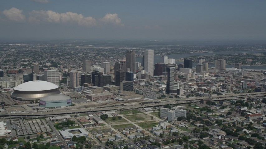 5K aerial video of Downtown New Orleans skyscrapers and Mercedes-Benz Superdome, Louisiana Aerial Stock Footage | AX59_029