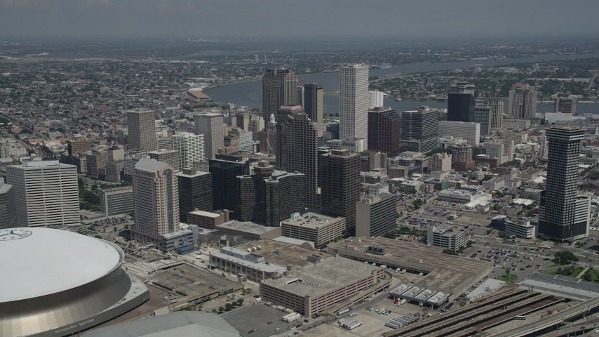 5K stock footage aerial video fly over Superdome and New Orleans arena to approach skyscrapers in Downtown New Orleans, Louisiana Aerial Stock Footage | AX59_030