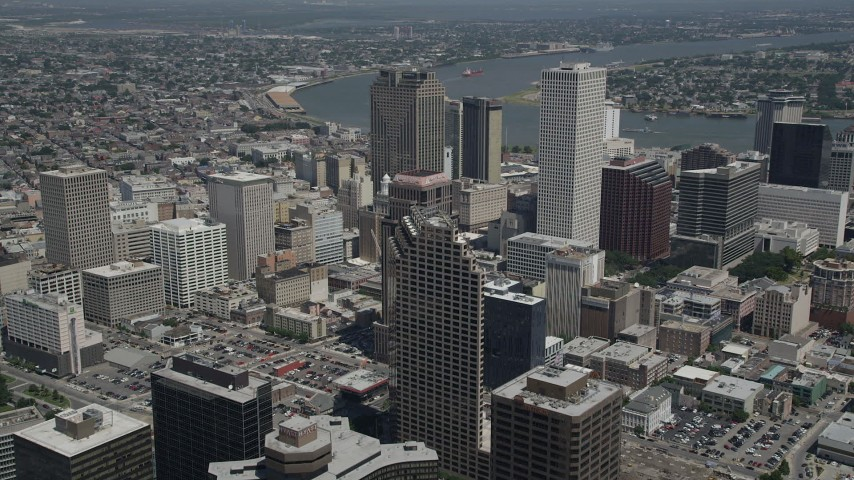 5K stock footage aerial video fly over Downtown New Orleans skyscrapers to approach Place St Charles, Louisiana Aerial Stock Footage | AX59_031