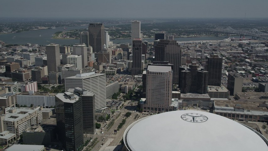 5K stock footage aerial video fly over the Superdome to approach skyscrapers in Downtown New Orleans, Louisiana Aerial Stock Footage | AX59_041