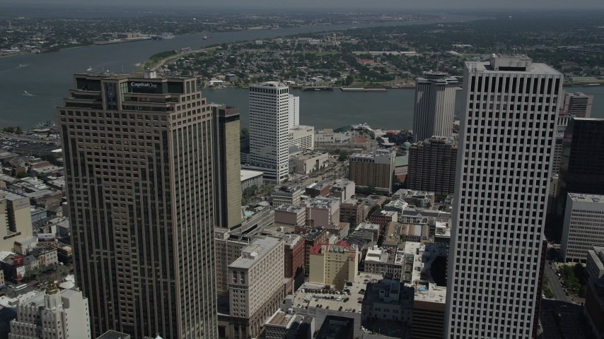 5K stock footage aerial video fly between Place St. Charles and One Shell Square in New Orleans, Louisiana, pan to reveal French Quarter Aerial Stock Footage | AX59_042