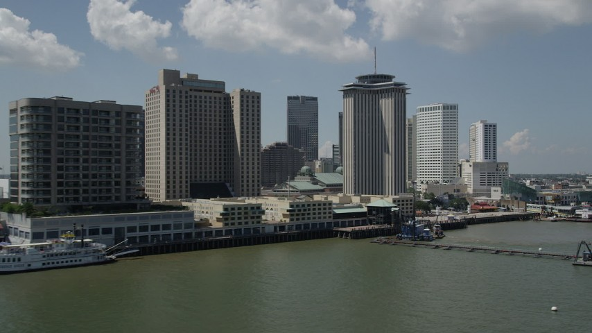 5K stock footage aerial video of Hilton New Orleans and World Trade Center seen from the Mississippi River, Downtown New Orleans, Louisiana  Aerial Stock Footage | AX59_044