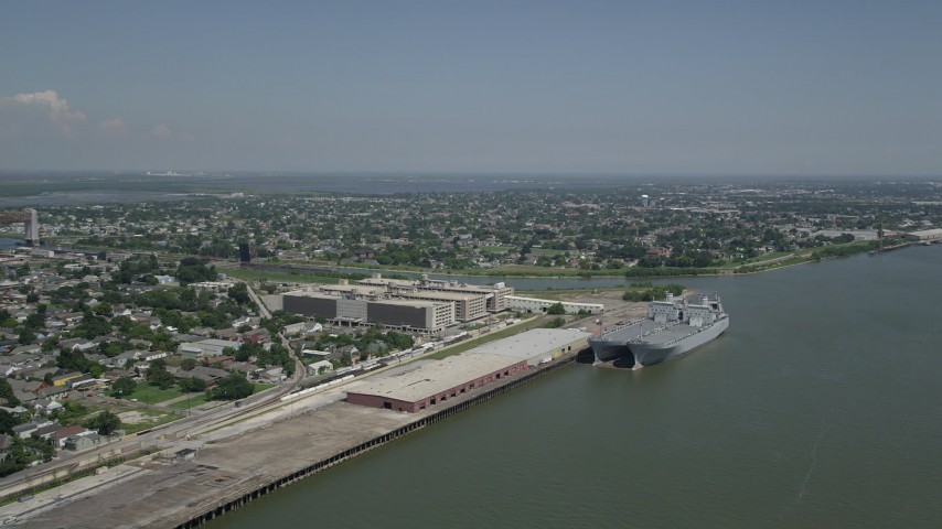 5K aerial video of two military transport ships docked at Bywater, New Orleans, Louisiana Aerial Stock Footage | AX59_046