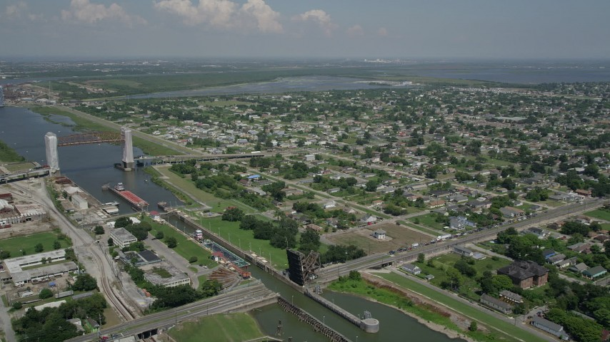 5K aerial video of barges in Industrial Canal and Lower Ninth Ward homes in New Orleans, Louisiana Aerial Stock Footage | AX59_048