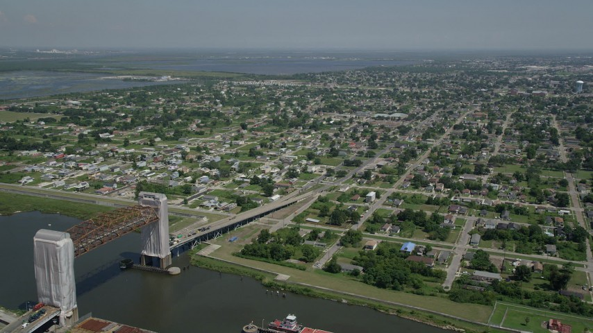 5K aerial video flyby Claiborne Avenue Bridge with a view of the Lower Ninth Ward, New Orleans, Louisiana Aerial Stock Footage | AX59_049