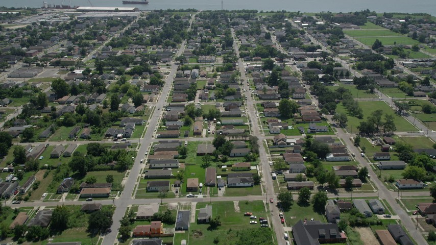 5K aerial video fly over the Lower Ninth Ward and approach the Mississippi River, New Orleans, Louisiana Aerial Stock Footage | AX59_054