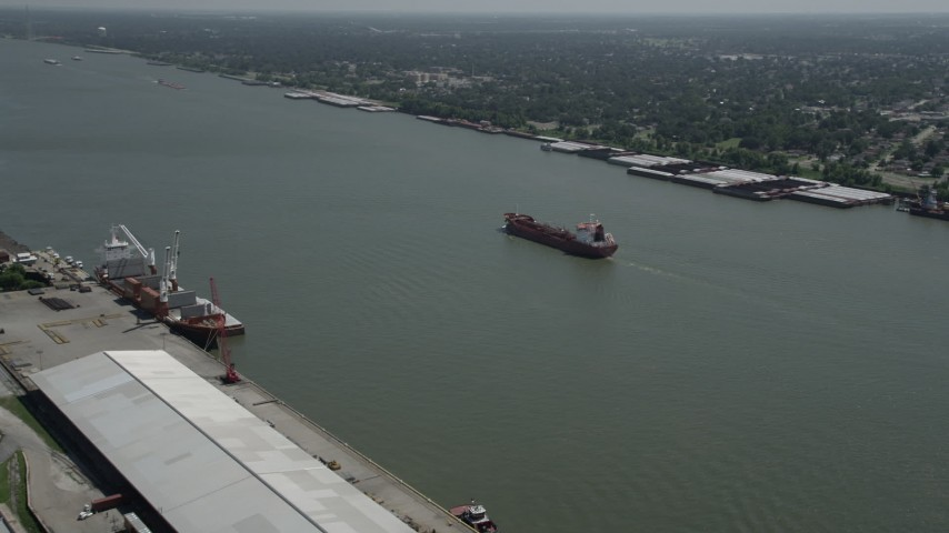 5K stock footage aerial video of an oil tanker sailing on Mississippi River, New Orleans, Louisiana Aerial Stock Footage | AX59_055