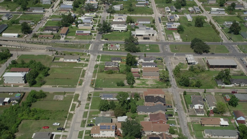5K aerial video fly over rows of homes in Lower Ninth Ward, New Orleans, Louisiana Aerial Stock Footage | AX59_057