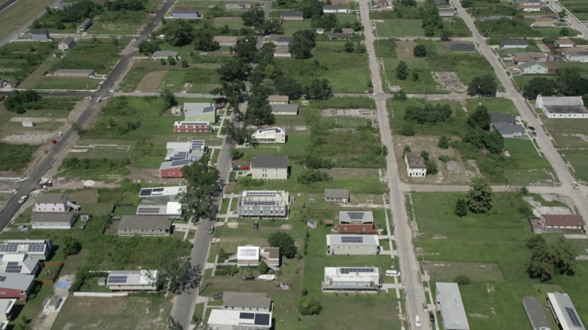 5K stock footage aerial video fly over homes and empty lots in the Lower Ninth Ward, New Orleans, Louisiana Aerial Stock Footage | AX59_058
