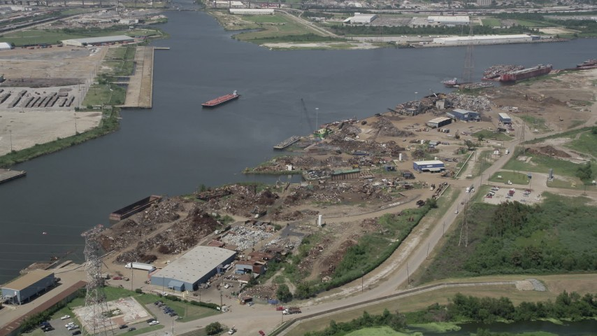 5K aerial video tilt to a bird's eye view of dump on bank of Industrial Canal, New Orleans, Louisiana Aerial Stock Footage | AX59_059