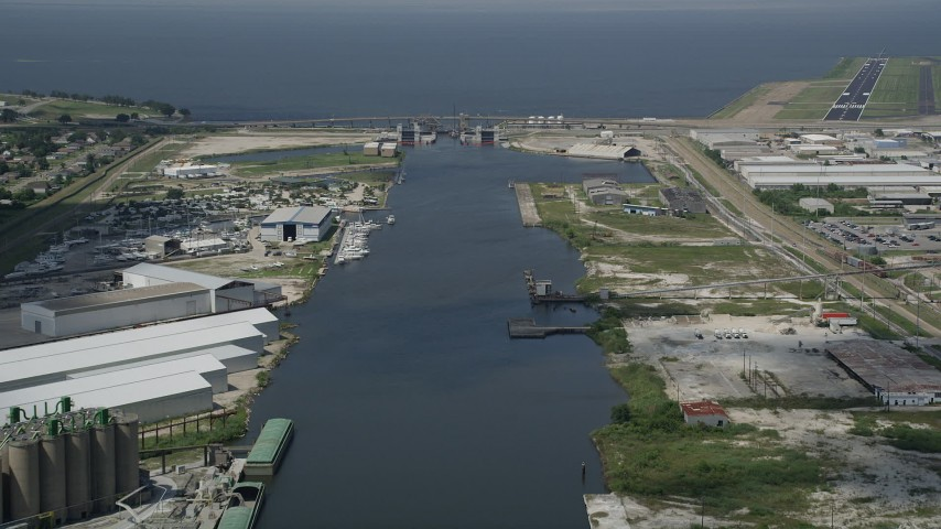 5K stock footage aerial video follow Industrial Canal toward the Seabrook Floodgate, New Orleans, Louisiana Aerial Stock Footage | AX59_063