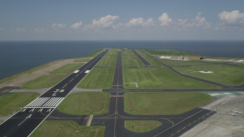 5K stock footage aerial video of runways and control tower at the New Orleans Lakefront Airport, Louisiana Aerial Stock Footage | AX59_066