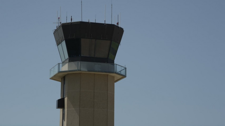 5K stock footage aerial video approach the control tower at New Orleans Lakefront Airport, Louisiana Aerial Stock Footage   AX59_068