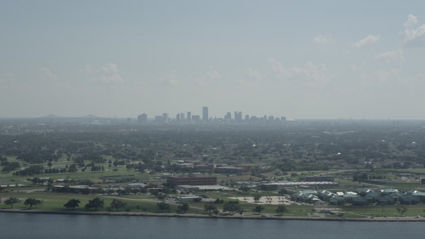 5K stock footage aerial video of Downtown New Orleans skyline seen from Lake Pontchartrain, Louisiana Aerial Stock Footage | AX60_001