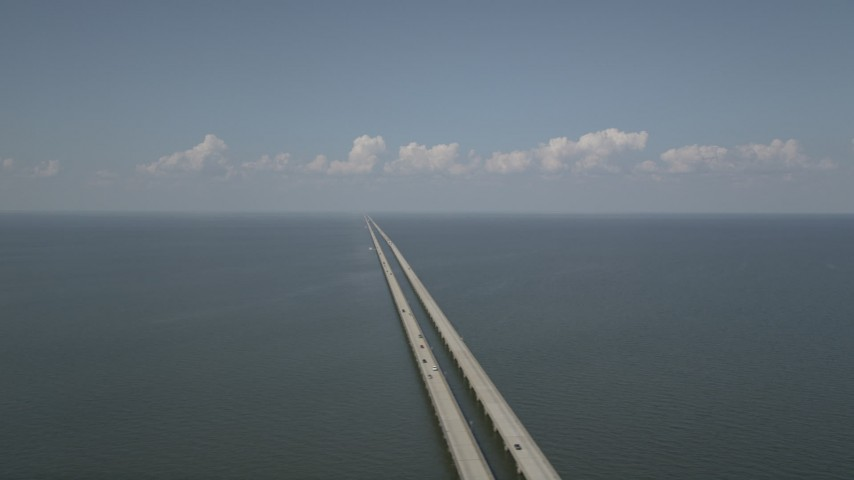 5K stock footage aerial video of Lake Pontchartrain Causeway, New Orleans, Louisiana Aerial Stock Footage AX60_003 | Axiom Images