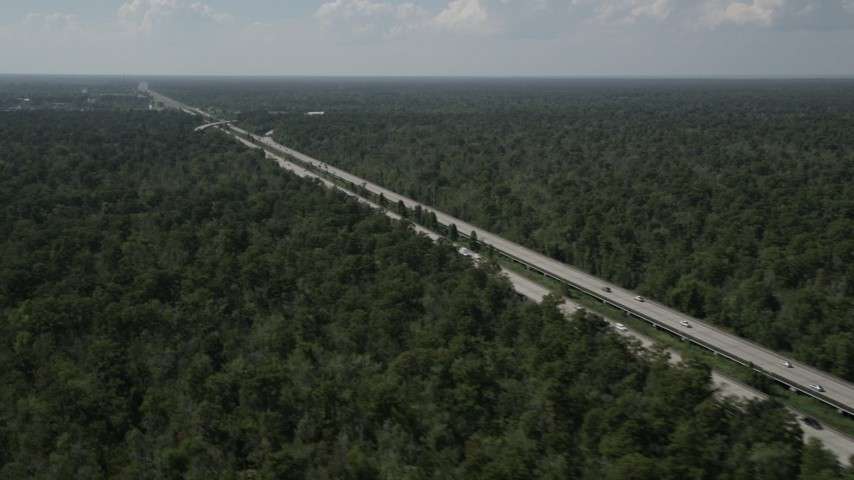 5K aerial video of Interstate 10 through swampland in La Place, Louisiana Aerial Stock Footage | AX60_010