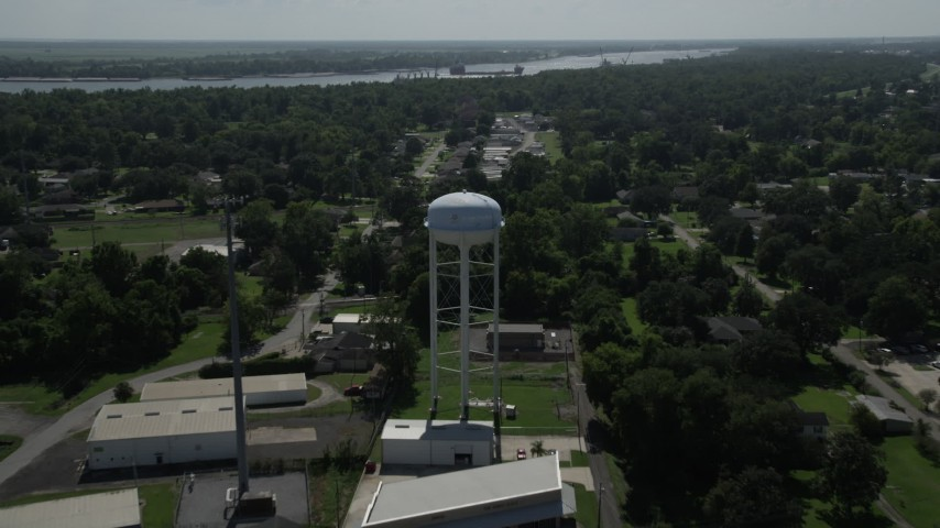 5K aerial video fly over trailer park and approach a water tower, La Place, Louisiana Aerial Stock Footage | AX60_013