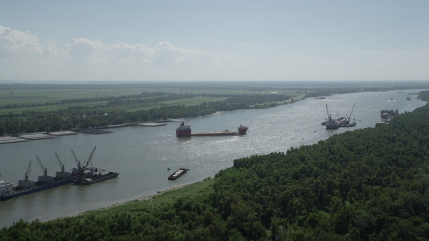 5K stock footage aerial video approach cargo ships anchored on Mississippi River near LaPlace, Louisiana Aerial Stock Footage | AX60_014