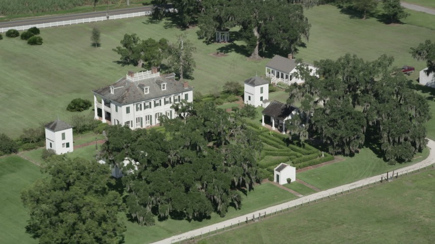 5K stock footage aerial video flying by the Evergreen Plantation house in Edgard, Louisiana Aerial Stock Footage | AX60_025
