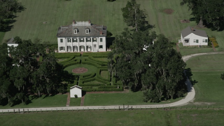 5K stock footage aerial video orbit the Evergreen Plantation and gardens in Edgard, Louisiana Aerial Stock Footage | AX60_026