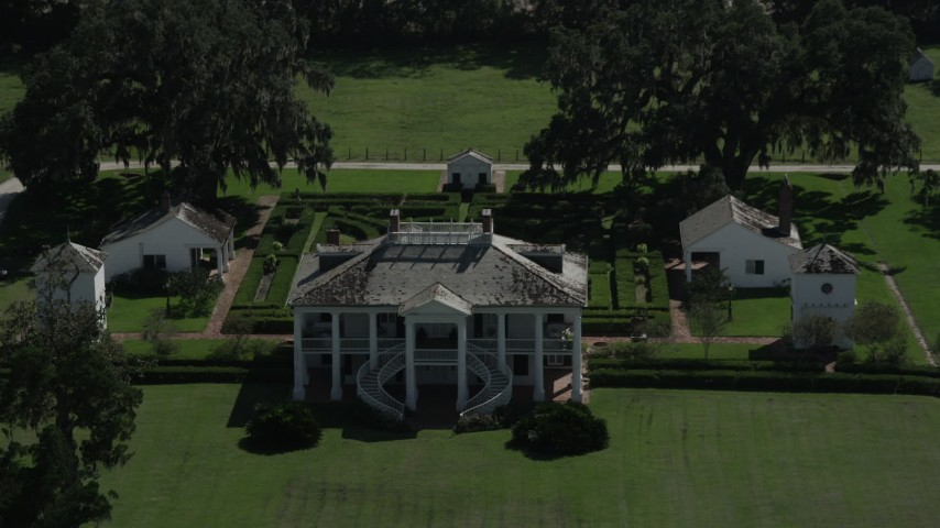 5K stock footage aerial video fly over trees to reveal Evergreen Plantation and gardens, Edgard, Louisiana Aerial Stock Footage | AX60_029