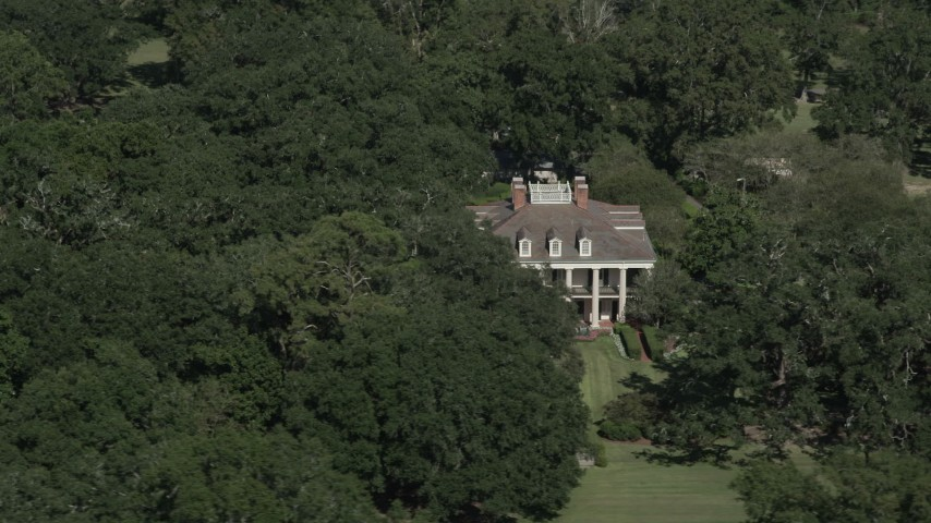 5K stock footage aerial video orbit the Oak Valley Plantation, partially hidden by trees in Vacherie, Louisiana Aerial Stock Footage | AX60_043