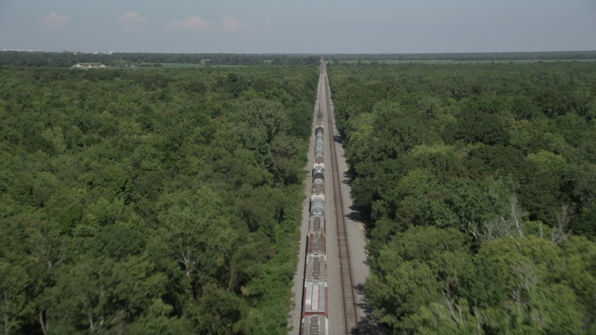 5K stock footage aerial video fly over train cars to approach the engine, Edgard, Louisiana Aerial Stock Footage | AX60_065