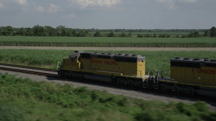 5K stock footage aerial video of tracking a train speeding past sugar cane fields, Edgard, Louisiana Aerial Stock Footage | AX60_067