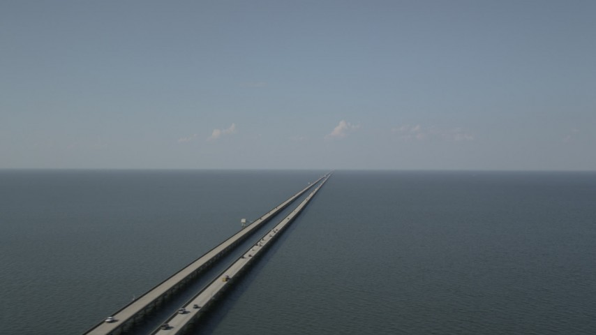 5K stock footage aerial video of the Lake Pontchartrain Causeway with light traffic in Louisiana Aerial Stock Footage | AX60_094