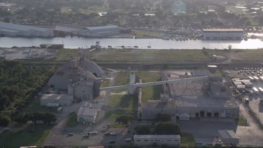 5K aerial video of a factory near Industrial Canal at sunset, New Orleans, Louisiana Aerial Stock Footage | AX61_001