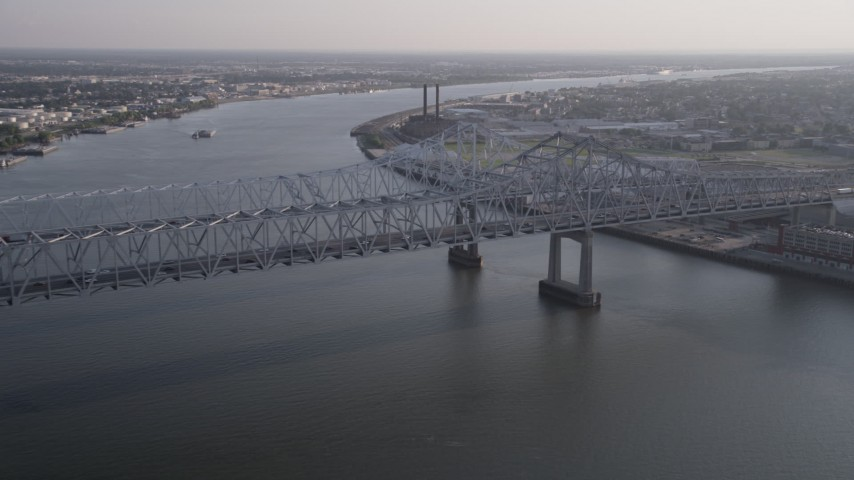 5K aerial video approach Crescent City Connection Bridge spanning Mississippi River at sunset, New Orleans Aerial Stock Footage | AX61_008