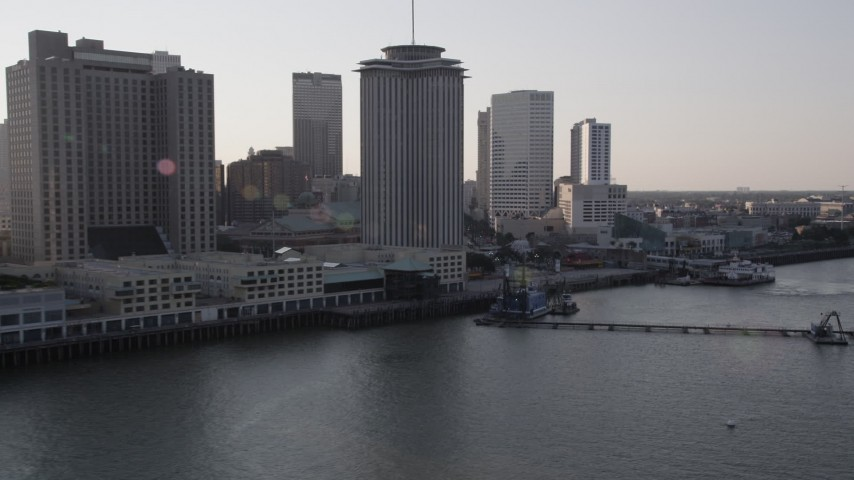 5K stock footage aerial video flyby riverfront skyscrapers at sunset in Downtown New Orleans, Louisiana Aerial Stock Footage | AX61_009