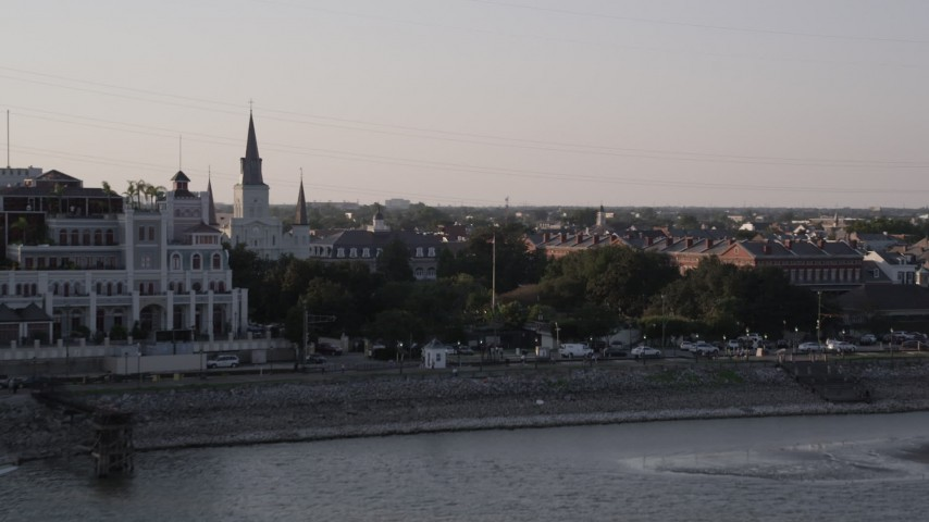 5K aerial video flyby Steamboat Natchez and Jax Brewery to reveal St. Louis Cathedral and Jackson Square at sunset, New Orleans, Louisiana Aerial Stock Footage | AX61_010
