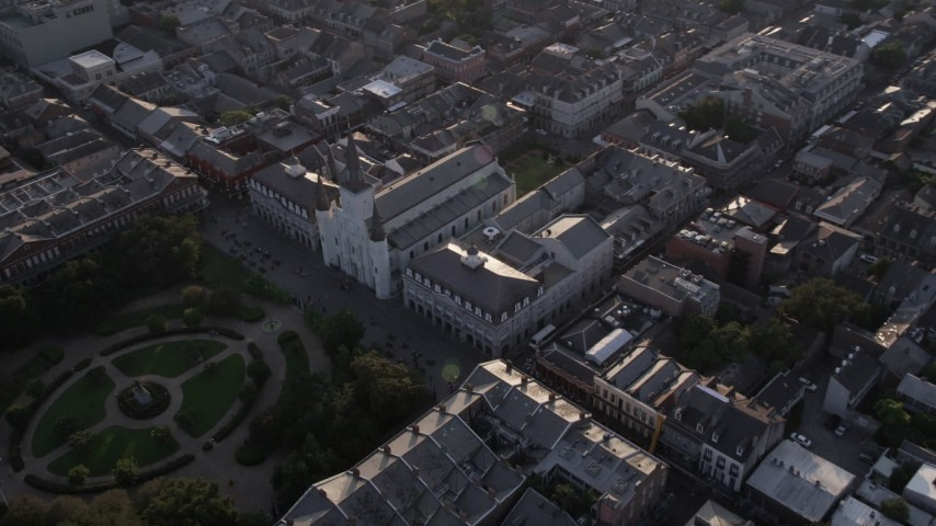 5K stock footage aerial video of St. Louis Cathedral and Jackson Square at sunset, New Orleans, Louisiana Aerial Stock Footage | AX61_011