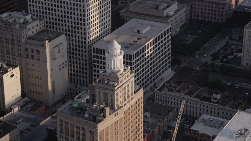 5K aerial video of the top of Hibernia Bank Building at sunset, Downtown New Orleans, Louisiana Aerial Stock Footage | AX61_012