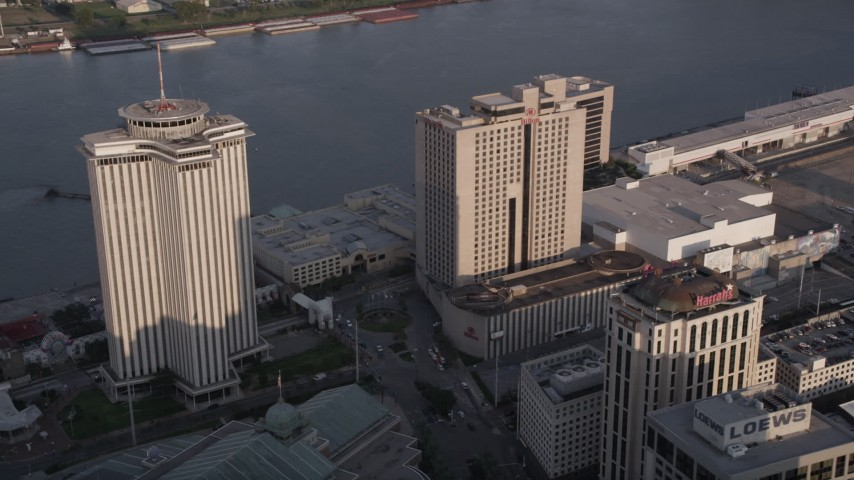 5K aerial video of World Trade Center and Hilton Riverside Hotel at sunset, New Orleans, Louisiana Aerial Stock Footage | AX61_013