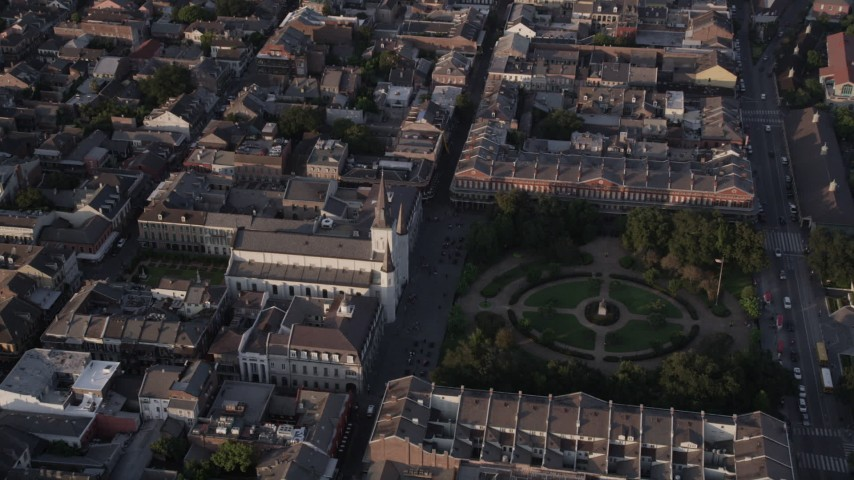 5K stock footage aerial video approach St. Louis Cathedral and Jackson Square at sunset, New Orleans, Louisiana Aerial Stock Footage | AX61_014