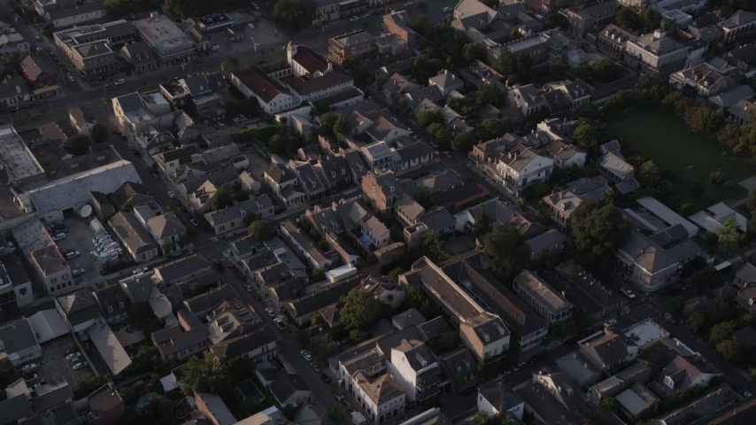 5K aerial video fly over the historic French Quarter in New Orleans at sunset, Louisiana Aerial Stock Footage | AX61_015